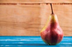 Ripe fresh pear on wood desk Stock Photos