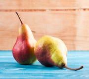 Ripe fresh pear on wood desk Royalty Free Stock Image