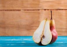 Ripe fresh pear on wood desk Royalty Free Stock Photo