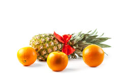 Ripe fresh pineapple and orange isolated on white background Stock Photography