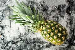Ripe fresh pineapple on wood desk. Royalty Free Stock Images