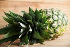 Ripe fresh pineapple on wood desk. Stock Photography