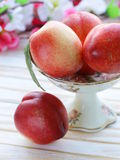 Ripe fresh pink peaches in vase Royalty Free Stock Image