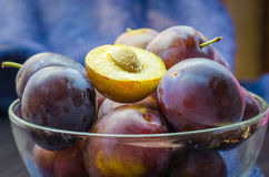 Plums in a bowl. Ripe fresh plums in a bowl on the table Royalty Free Stock Photo