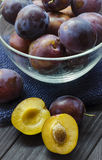 Plums in a bowl. Ripe fresh plums in a bowl on the table Stock Photo