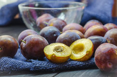 Plums in a bowl Stock Images