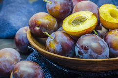Plums in a bowl. Ripe fresh plums in a bowl on the table Royalty Free Stock Images