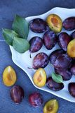 Fresh Plums in a tray, top view Royalty Free Stock Image