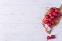 Ripe fresh radish. On white wooden background Royalty Free Stock Photography