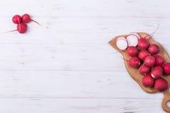 Ripe fresh radish. On white wooden background Stock Photography