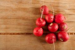 Ripe fresh radish. On wood desk. Food ingredients Stock Photography