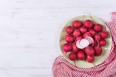 Ripe fresh radish. On white wooden background Stock Image