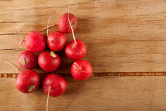 Ripe fresh radish. On wood desk. Food background Royalty Free Stock Photo