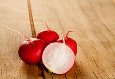 Ripe fresh radish. On wood desk. Food background Stock Photos