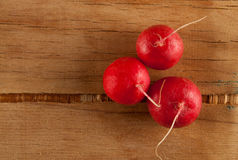 Ripe fresh radish. On wood desk. Food background Royalty Free Stock Image