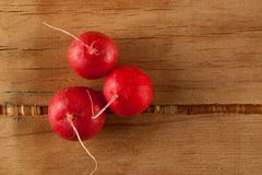 Ripe fresh radish. On wood desk. Food ingredients Royalty Free Stock Photography