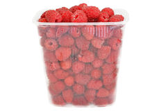 Ripe fresh raspberries. In � transparent plastic container isolated on white background Stock Image