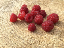 Ripe fresh raspberries on a wooden background Stock Images