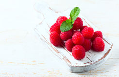 Ripe fresh raspberries on a wooden background. Selective focus Royalty Free Stock Photo