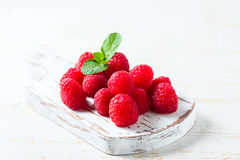 Ripe fresh raspberries on a wooden background. Selective focus Stock Photos