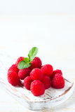 Ripe fresh raspberries on a wooden background. Royalty Free Stock Photo
