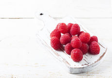 Ripe fresh raspberries on a wooden background. Selective focus Royalty Free Stock Image