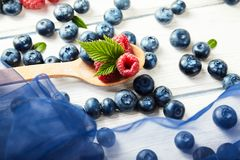 Ripe fresh raspberry and blueberry close up. Food ingredients Royalty Free Stock Images