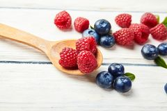 Ripe fresh raspberry and blueberry close up. Food ingredients Stock Images