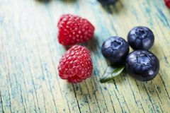 Ripe fresh raspberry and blueberry close up. Food ingredients Stock Photography