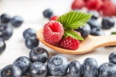 Ripe fresh raspberry and blueberry close up. Food ingredients Royalty Free Stock Photography