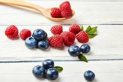 Ripe fresh raspberry and blueberry close up. Food ingredients Stock Photos