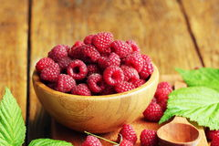 Ripe fresh raspberry. In wooden bowl Royalty Free Stock Image