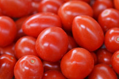 Ripe fresh red tomatoes on a market Stock Image