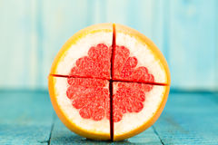 Ripe fresh sliced grapefruit on wooden background. Diet, vegetarianism, healthy food Royalty Free Stock Image
