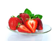 Ripe fresh strawberries on plate Stock Images