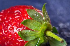 Ripe fresh strawberry with water drops - macro Royalty Free Stock Photography