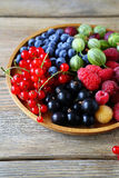 Ripe and fresh summer berries on plate Royalty Free Stock Photos