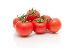Ripe fresh tomatoes closeup on a white background Stock Photography