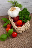 Ripe fresh tomatoes, garlic and herbs Royalty Free Stock Photography