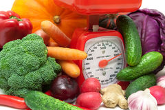 Ripe fresh vegetables and kitchen scale closeup Royalty Free Stock Images