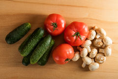 Ripe fresh vegetables on wood table. Food background Royalty Free Stock Photography