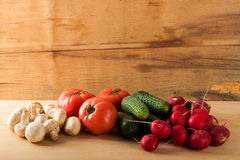 Ripe fresh vegetables on wood table. Food background Stock Images