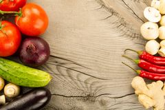 Ripe fresh vegetables on wooden background. The icon for healthy eating, diets. Weight loss stock images