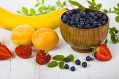 Ripe fruit and berries: bananas, blueberries, apricots, strawber Royalty Free Stock Images