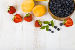 Ripe fruit and berries: bananas, blueberries, apricots, strawber Stock Image