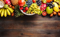Ripe fruit and berries on a wooden background stock image