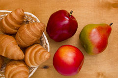 Ripe fruit and croissants Stock Photos