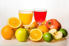 Ripe fruit and fresh juice on whiteon white. Royalty Free Stock Photo