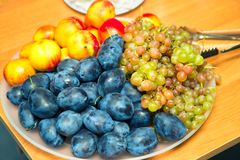 Ripe fruit on the holiday table Stock Image