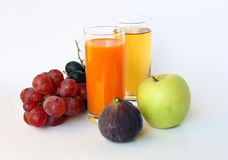 Ripe fruit and two glasses of juice Stock Photography